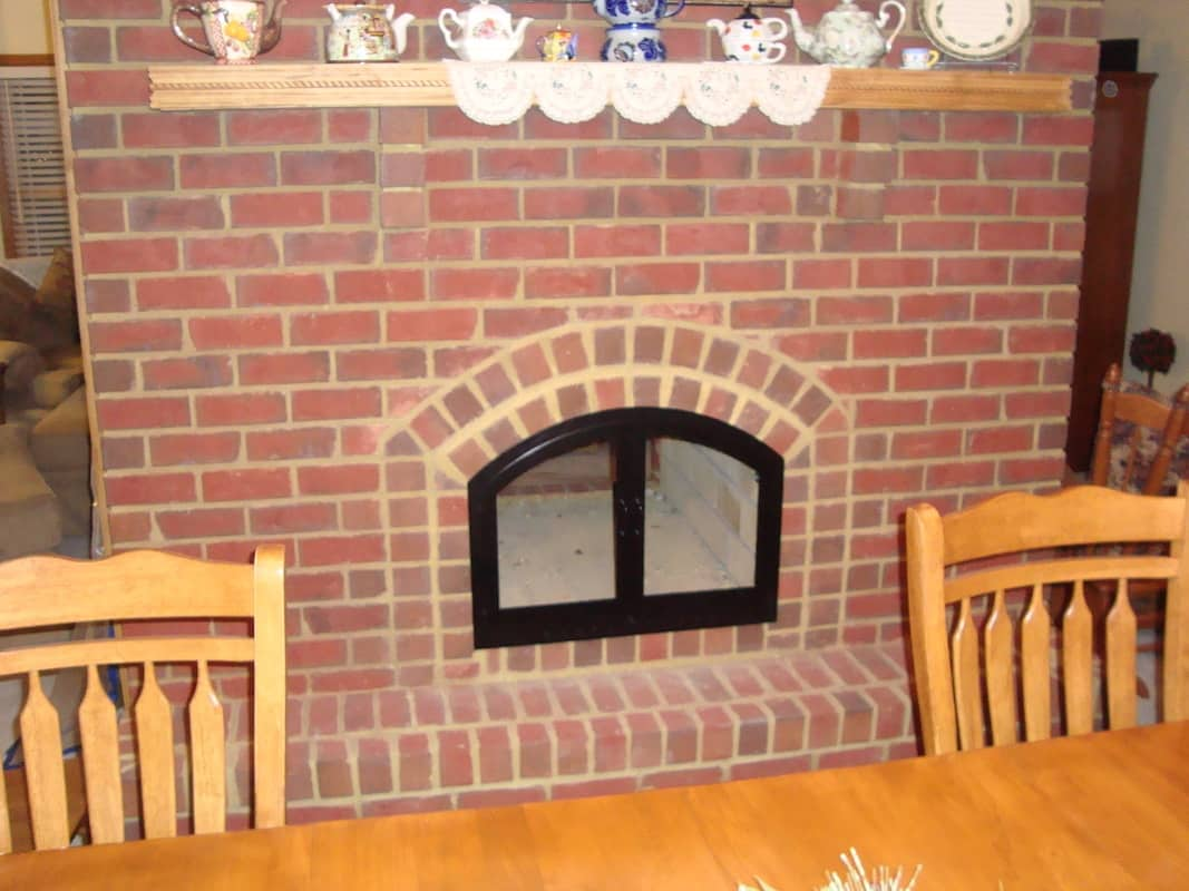 Arched black fireplace